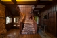 The majestic entrance to a gorgeous home. Dark wood paneling is a particular Hooper favourite.