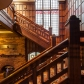 The impressive main staircase highlights Hooper's typical  wood panelling. Graham Warman photographer.